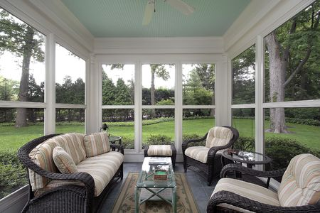 Porch in suburban home with wicker furniture Stock Photo