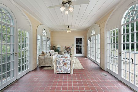 Porch in suburban home with red brick floor Stock Photo