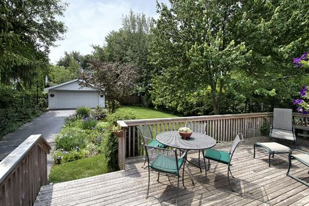 Deck with table and chairs with view to yard photo