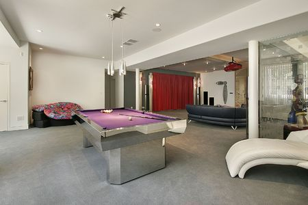 pool room: Lower level in luxury home with pool table Stock Photo