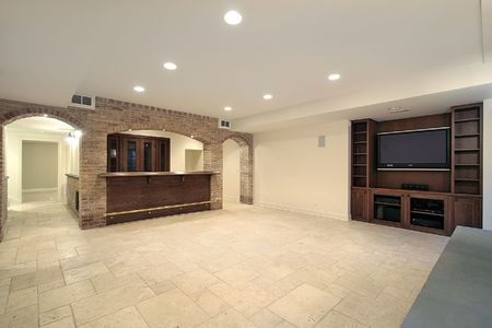 Basement in new construction home with bar photo