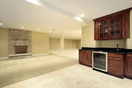 Basement in new construction home with bar and fireplace Stock Photo - 6738255