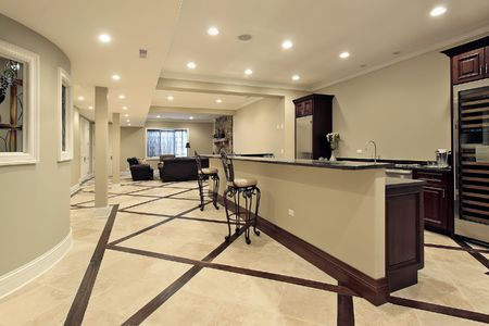 Lower level in luxury home with bar area photo