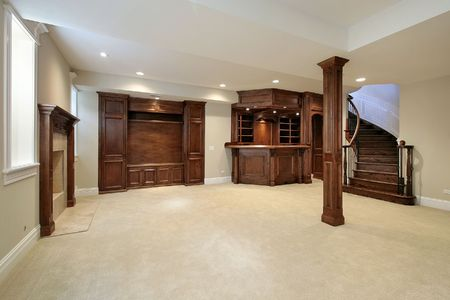 Basement in new construction home with wood cabinetry photo