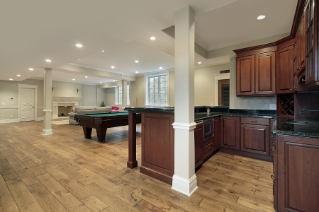 floor lamp: Basement in new construction home with bar and fireplace