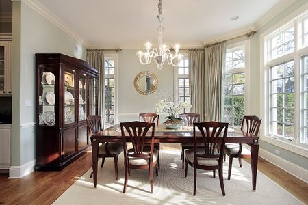 Dining room in luxury home with bay window photo