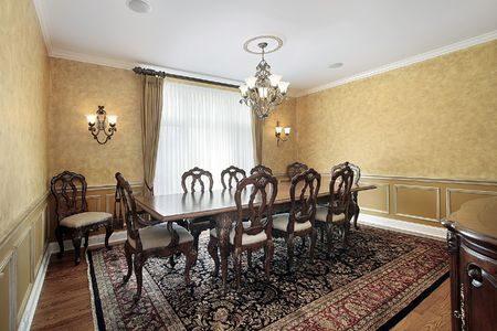 Elegant dining room with large table in luxury home Stockfoto