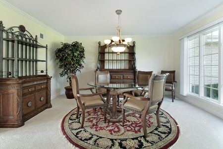 Dining room in suburban home with round table photo