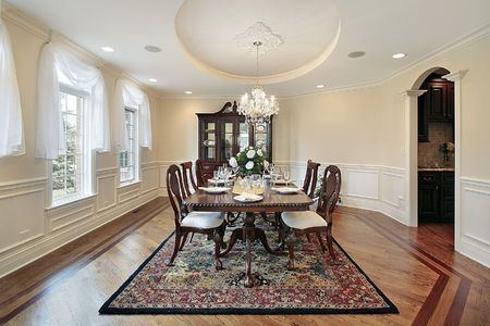 Dining room in luxury home with oval ceiling Foto de archivo