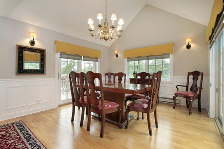 Dining room in suburban condo with balcony view photo