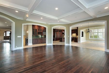 Family room in new construction home with kitchen view photo