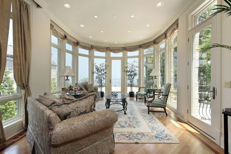 luxury room: Family room in modern home with lake view Stock Photo
