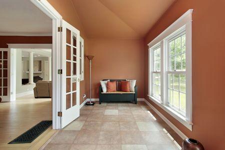 den: Den in luxury home with orange walls