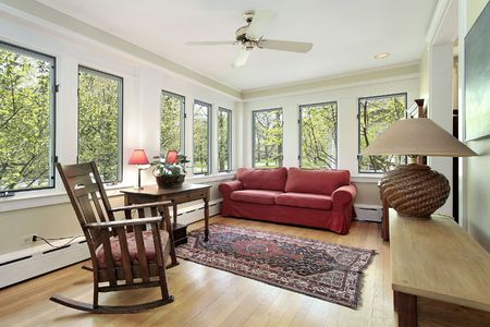 Den in suburban home with wall of windows photo