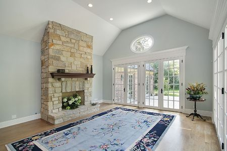 Family room in suburban home with stone fireplace photo