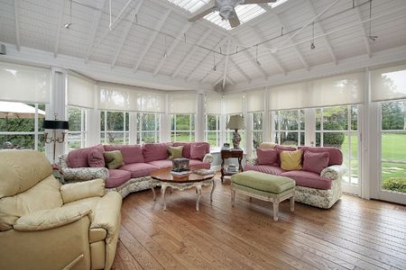 Family room in luxury home with wall of windows photo