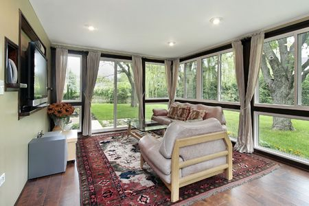 sunroom: Sunroom in suburban home with outside view Stock Photo