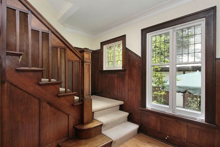 Foyer: Foyer in traditional home with stained glass window Stock Photo