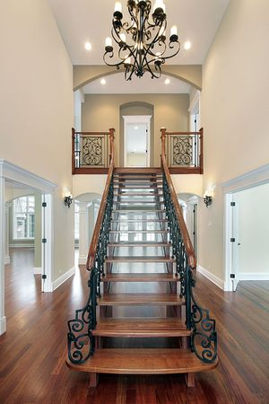traditional living room: Elaborate railing on stairway in new construction home Stock Photo