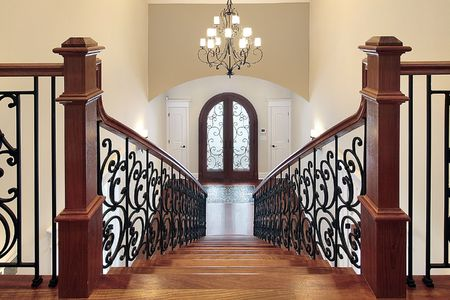 Elaborate stairway leading down into foyer in new construction home photo
