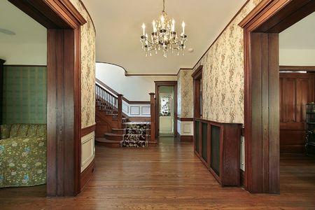 elegant staircase: Foyer in older home with wood paneling