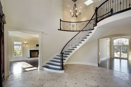 Foyer in new construction home with circular staircase photo