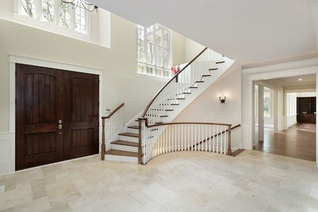 Foyer in new construction home with circular staircase Stock Photo - 6738494