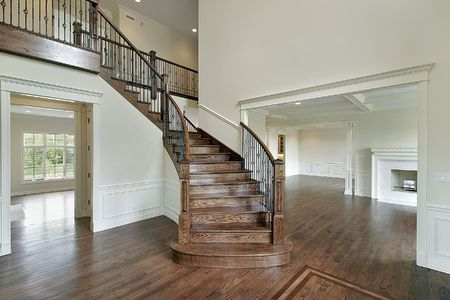 Foyer in new construction home with wooden staircase photo