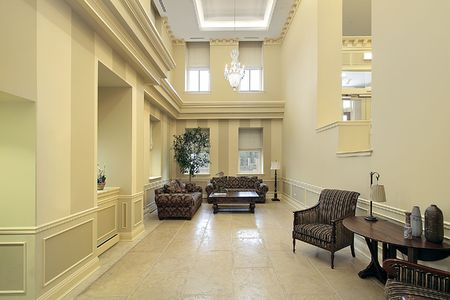 Lobby in condominium complex with sitting area photo