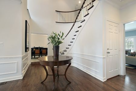 entryway: Foyer in luxury home with curved staircase