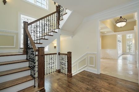Foyer in new construction home with wood staircase photo