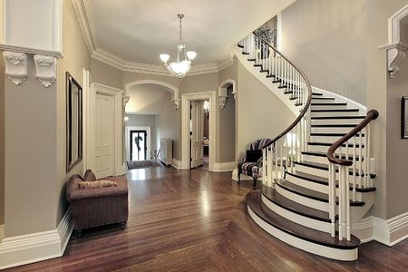 entryway: Foyer in traditional suburban home with curved staircase Stock Photo