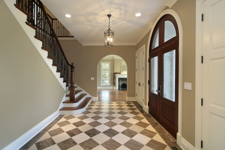Foyer in new construction home with checkerboard floor photo