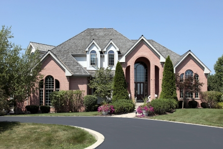 driveways: Luxury brick home in suburbs with cedar roof Stock Photo