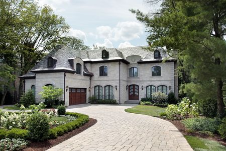 Front view of luxury home with circular driveway