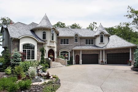 costly: Front view of luxury brick home with two turrets