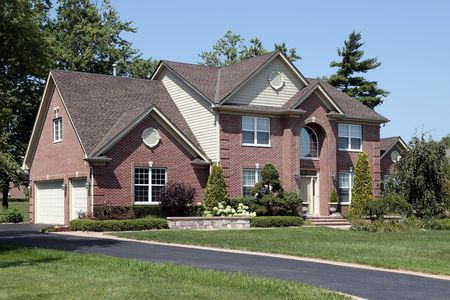 Luxury brick home in suburbs with arched entry Stock Photo - 6739459