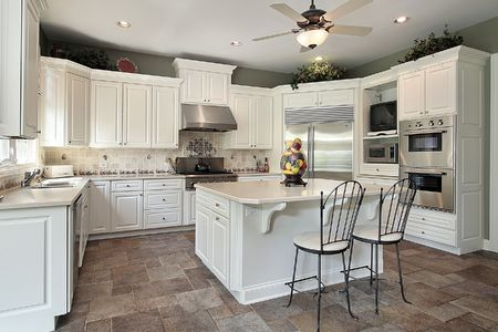 Kitchen in luxury home with large white island photo