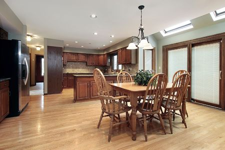 Kitchen and eating area in luxury home photo