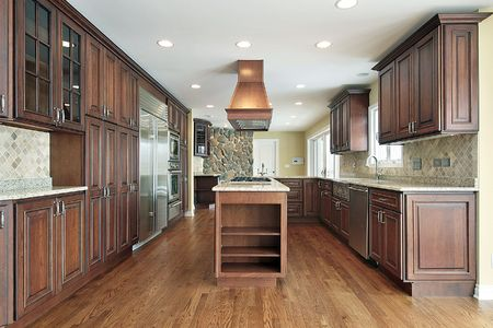 kitchen furniture: Kitchen in new construction home with cherry wood cabinetry