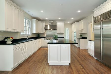 kitchen island: Kitchen in new construction home with white cabinetry