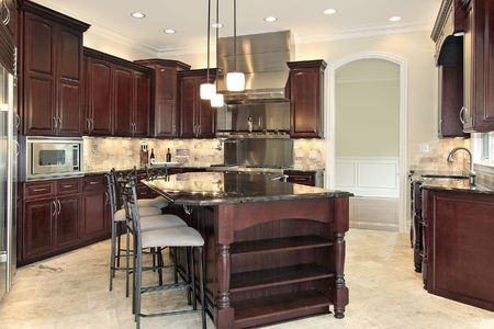 island: Kitchen in new construction home with cherry wood cabinetry