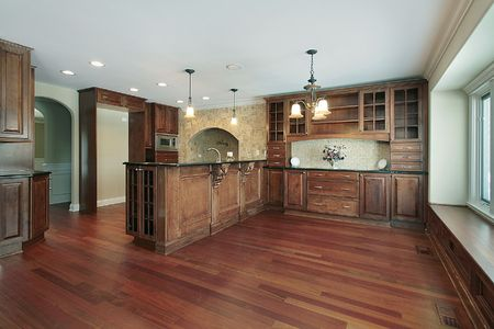 island: Kitchen in luxury home with cherry wood cabinetry Stock Photo