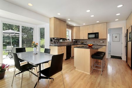 Kitchen in suburban home with oak wood cabinetry photo