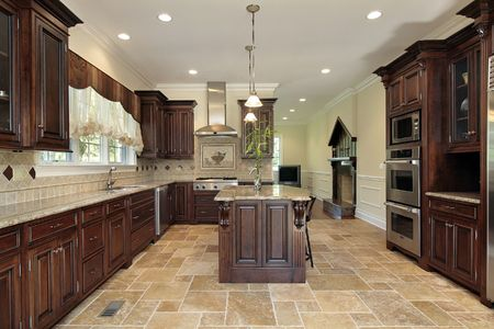 kitchen tiles: Large kitchen in luxury home with cherry wood cabinetry Stock Photo