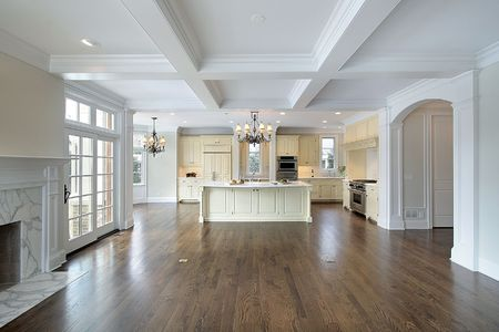 Kitchen and family room with island in luxury home photo
