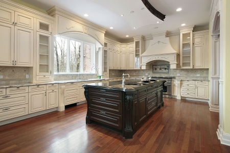 Large kitchen in new construction home with granite island