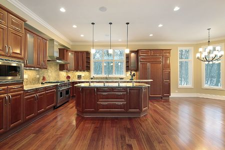 Kitchen and eating area with island in luxury home Stock Photo - 6738647