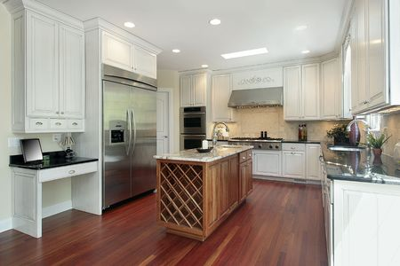 Kitchen with wood island in new construction home photo