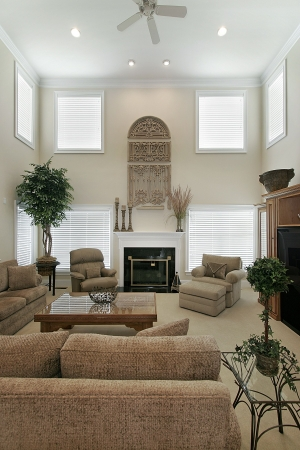 Two story living room with marble fireplace photo